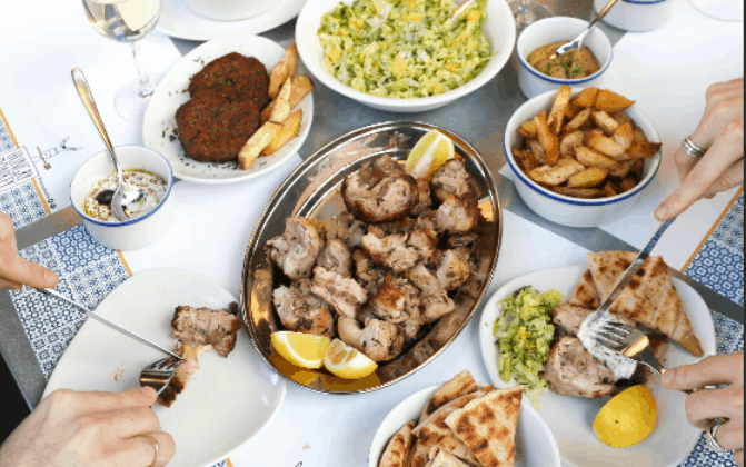 An image of Greek food on a table